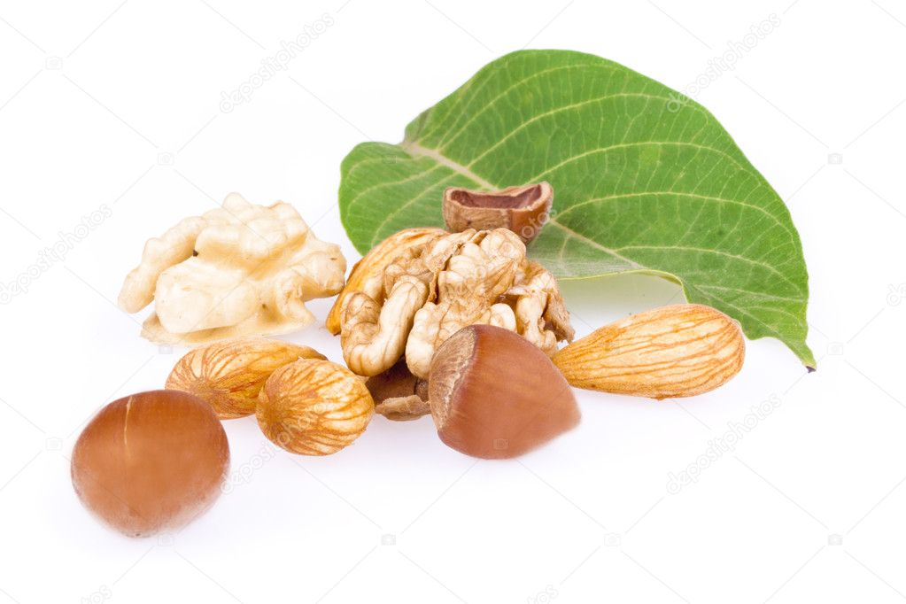 Walnuts, hazelnuts and almonds isolated on a white background — Stock Photo #6631903