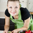 Young woman cooks dinner in the kitchen — Stock Photo #6678760
