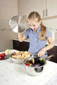 Little girl preparing food in the kitchen — Stock Photo