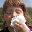 Foto de Stock  : Allergies - girl wipe your nose with tissue