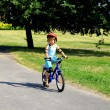 Girl riding on bicycle — Stock Photo #6300214