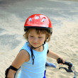 Little girl in a red helmet — Stock Photo #6300243