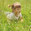 Four years old girl lies in the grass — Stock Photo