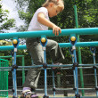 A girl walking on the ladder at the playground — Stock Photo #6300403