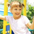 Happy girl playing on the playground — Stock Photo #6300410