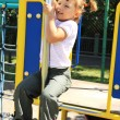 Stock Photo: Young girl on playground