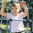 Four year old girl on the playground - Stockfoto