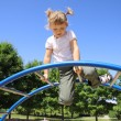 The four-year girl playing on the playground — Stock Photo #6300451
