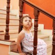 Girl sitting on the stairs — Stock Photo