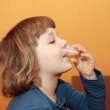 The girl takes the medicine. He drinks syrup — Stock Photo #6305592
