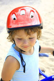 Portrait little girl in a red helmet — Stock Photo