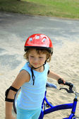 Little girl in a red helmet — Stock Photo