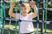 Four year old girl on the playground — Стоковое фото