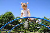 The four-year girl playing on the playground — Stock Photo
