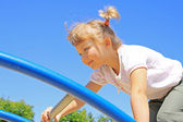 Young girl goes across the ladder — Stock Photo
