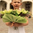 Girl with a bouquet of flowers - Stockfoto
