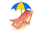 Chaise Longue and umbrella — Stock Photo