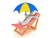 Chaise Longue, person and umbrella — Stok fotoğraf