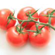 Five red tomatoes - Stock Photo