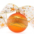 Orange christmas ball with decorative ribbon — Stock Photo
