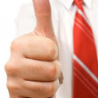 Businessman giving thumbs up — Stock Photo