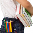Back to school - kid with colorful books and pencils — Stock Photo