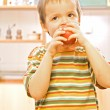 Boy eating an apple — Stock Photo #6409201