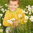 Little boy with flowers — Stock Photo #6409207
