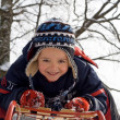 Kid on a sledge — Stock Photo