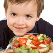 Little smiling boy with a bowl of sliced fruits — Stock Photo #6409288
