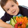 Little boy with fresh vegetables — Stock Photo