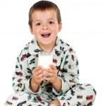 Happy kid with his bedtime glass of milk — Stock Photo #6409298