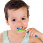 Little boy brushing teeth — Stock Photo #6409303