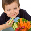Happy little boy with a bowl of fresh vegetables — Stock Photo #6409310