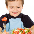 Boy about to eat a large bowl of fresh fruit salad — Stock Photo