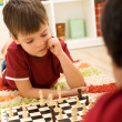 Stock Photo: Serious chess player kid
