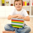 Schoolboy with books sitting on the floor — Stock Photo