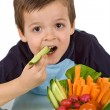 Healthy little boy with a bowl of vegetables - Stock Photo