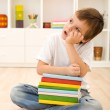 Bored kid with lots of school books — Stock Photo #6409365