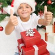 Happy boy with lots of christmas presents — Stock Photo