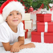 Happy boy with lots of christmas presents - Stock Photo