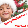 Happy boy with christmas hat and white banner — Stock Photo