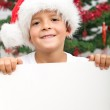 Boy with banner and christmas hat — Stock Photo #6409381