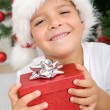 Happy boy with christmas present — Stock Photo