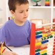 Kid doing math exercise — Stock Photo