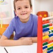 Happy kid solving math exercise — Stock Photo #6409418