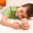Happy kid relaxing with music — Stock Photo #6409423