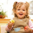 Happy girl with easter egg and decoration in hands - Foto Stock