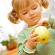 Cute girl with apple — Stock Photo #6409550