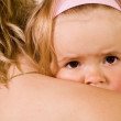 Little girl cuddling with her mother - closeup — Stock Photo #6409557